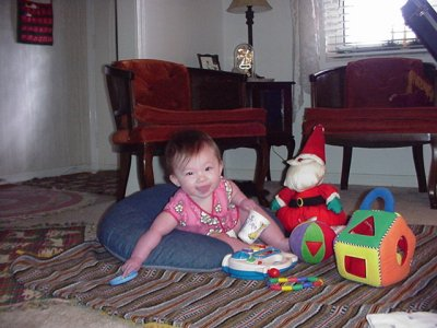 Ashlyn with her toy Santa